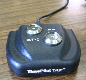 TimePilot Tap+ used as a desk timeclock.