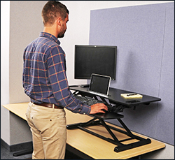 The standing desk rises from 4.2 to 19.7 inches above your desk height.